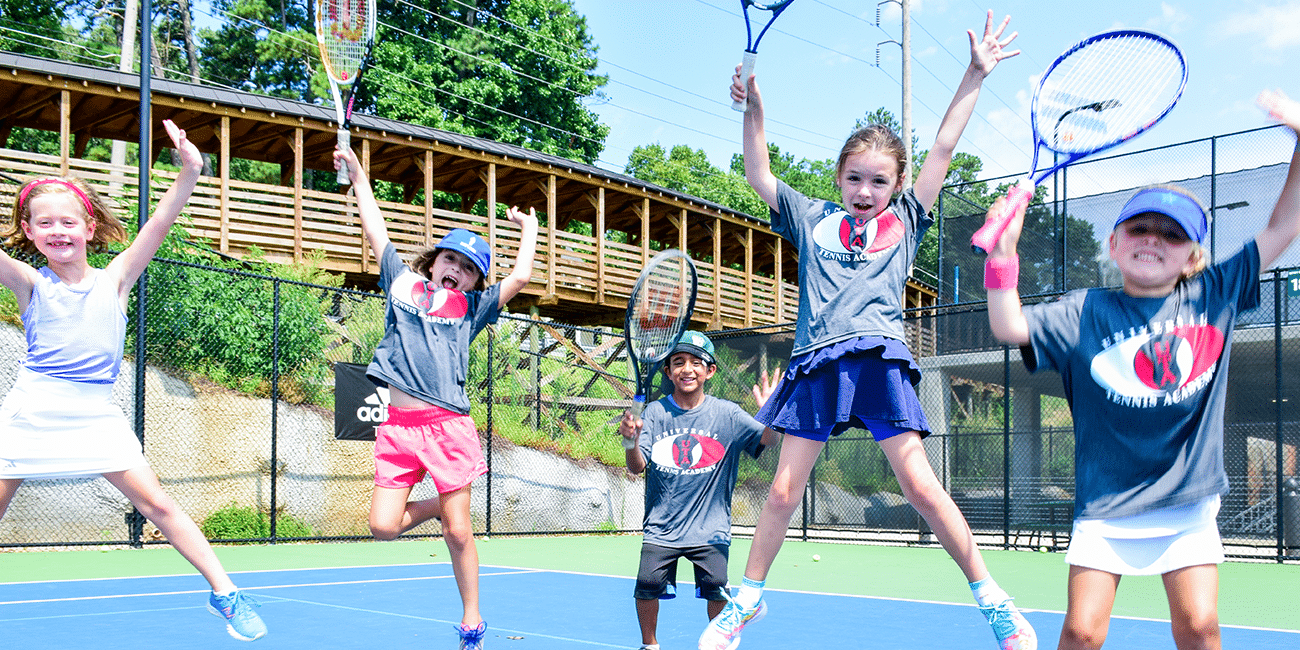 UTA (Universal Tennis Academy) Bitsy Grant Summer Camp Girls Jumping in Air