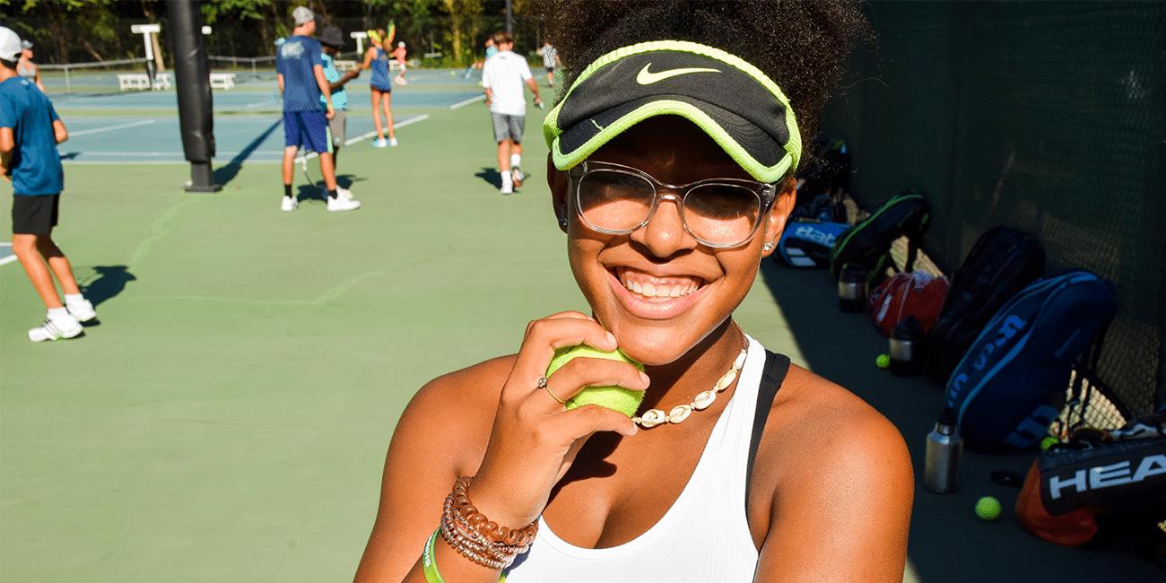 UTA (Universal Tennis Academy) Blackburn Junior Holding Tennis Ball