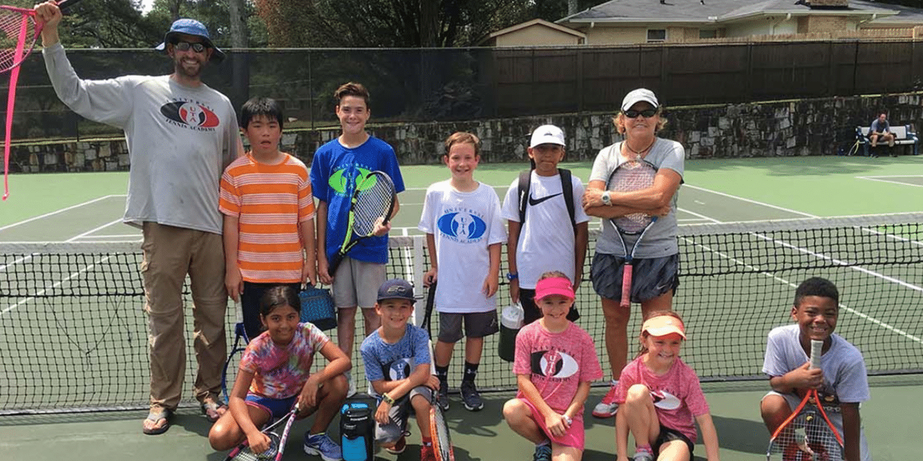 UTA (Universal Tennis Academy) Briarlake Summer Mixed Group on Court