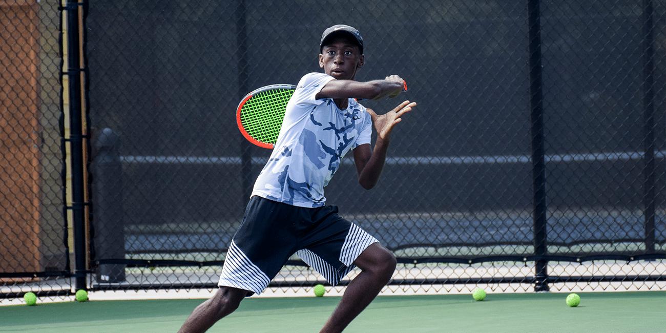 UTA (Universal Tennis Academy) Bitsy Grant Junior Program Boy With Neon Racket