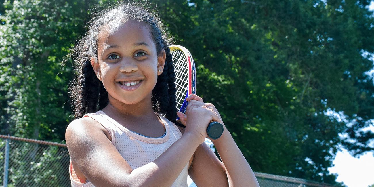UTA (Universal Tennis Academy) McGhee Junior Program Girl W/ Racket On Shoulder