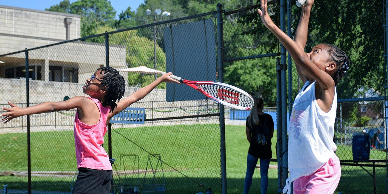 UTA (Universal Tennis Academy) McGhee Junior Programs Girls in Pink Serving