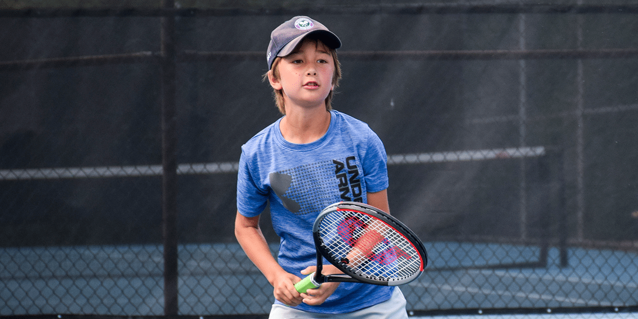 UTA (Universal Tennis Academy)Piedmont Park Junior Programs Boy Returning Ball