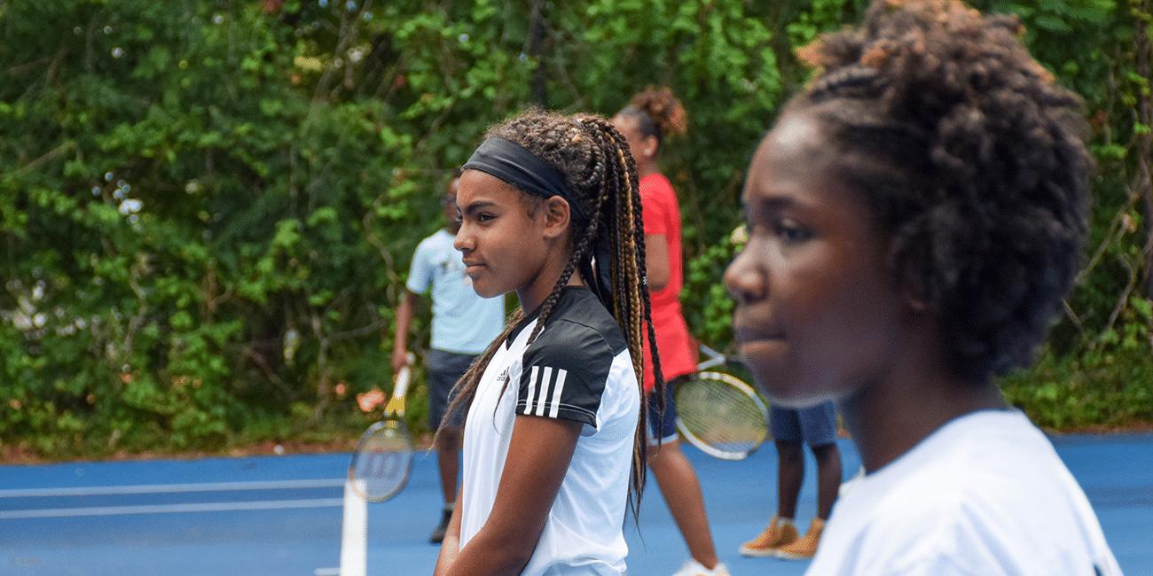 UTA (Universal Tennis Academy) Washington Junior Programs 2 Girls in White
