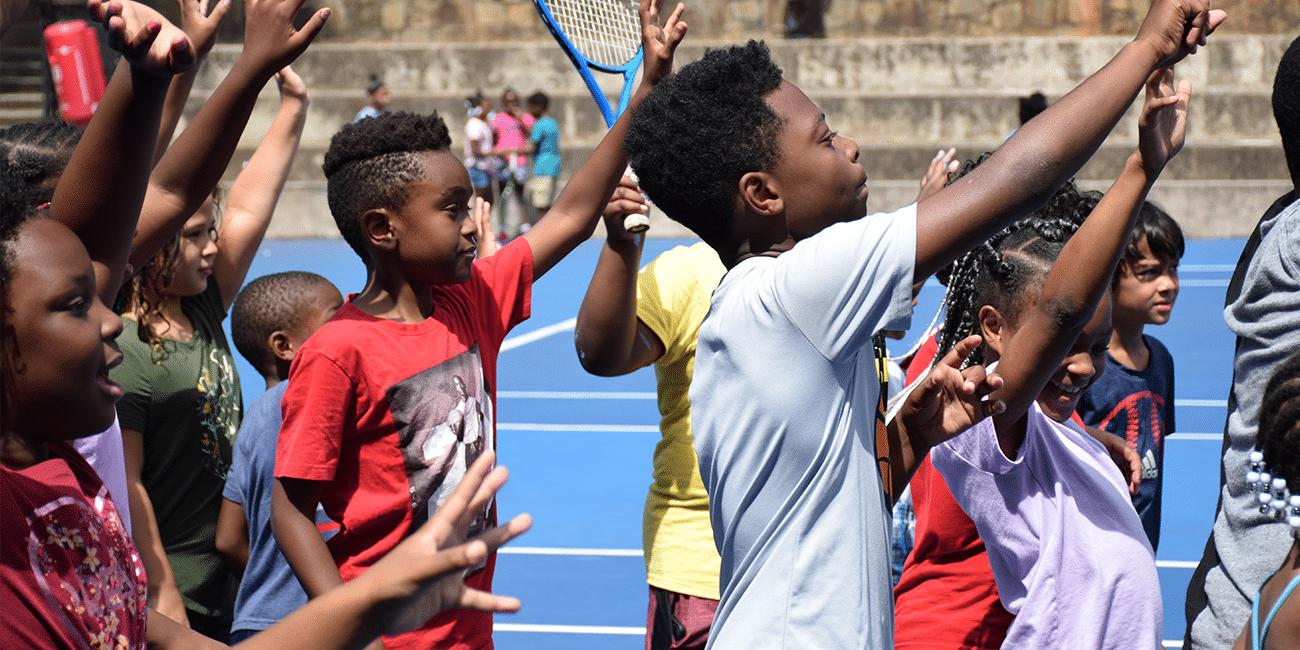 UTA (Universal Tennis Academy) Washington Summer Camp Kids Raising Hands